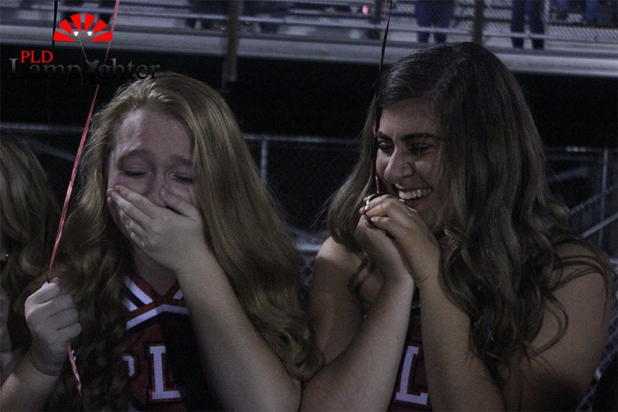 Jordan Scholl and Rebecca Pollack get emotional at their last game.