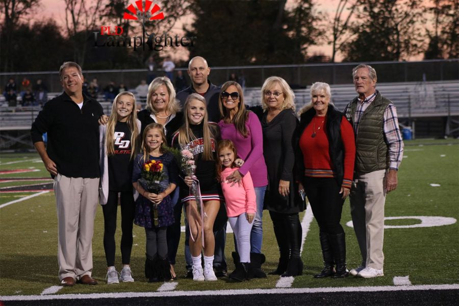 Abby Rawls and her family on senior night.