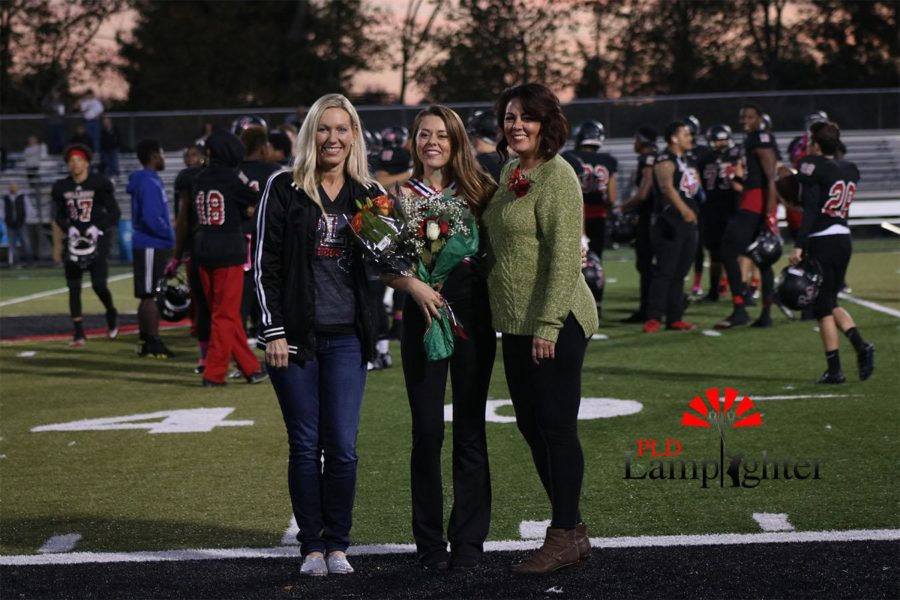 Elise Cammack poses with her mother (right) and Dance Team Coach Teresa Champe (left).