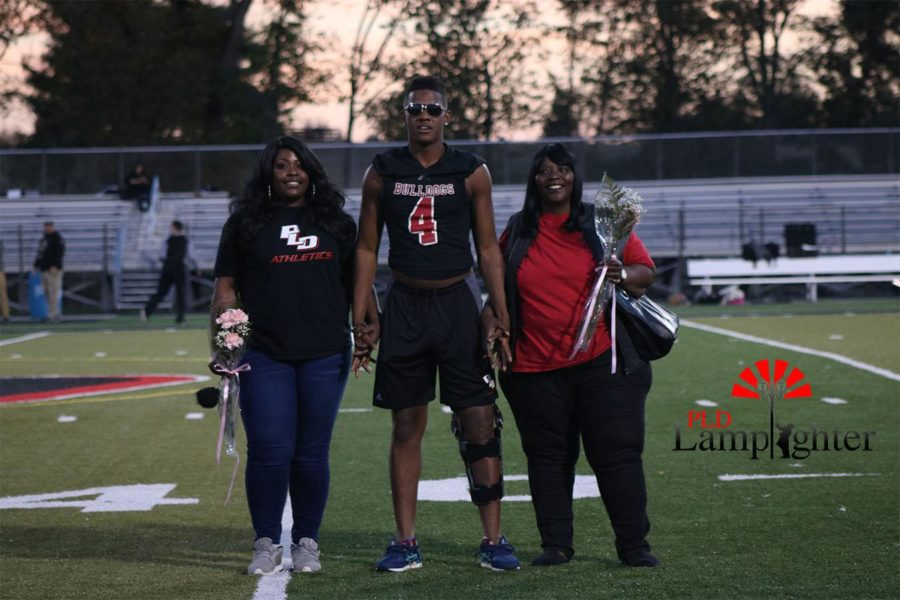 Dontell Brown (#4) poses for a photo with his family.