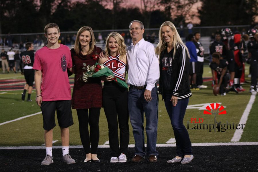 Taylor Kemper celebrates with her family on Senior night.