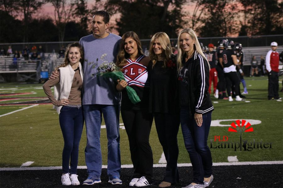 Rebecca Pollack with her family on senior night.