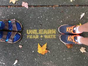 Unlearn Fear and Hate stencils can be found all over Lexington.