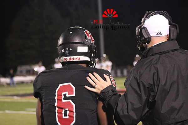 Junior Nate Gay talks with his coach.