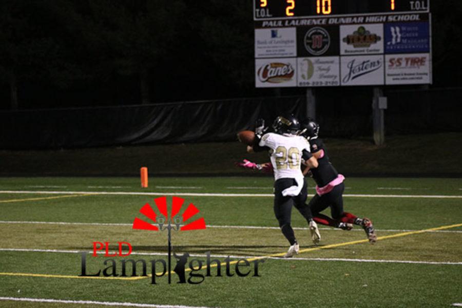 A Dunbar player reaches for the ball.