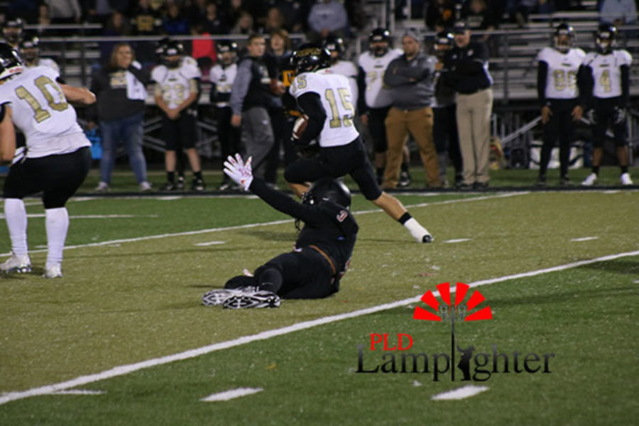 #3 Kaden Gaylord dives for the ball.