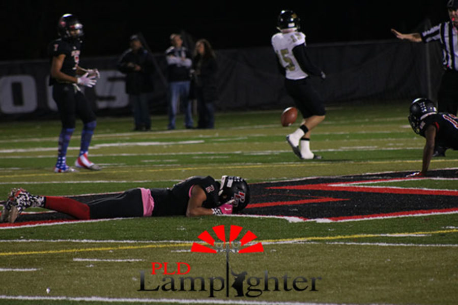 Senior Isaiah Yeast (#2) lies on the ground after a play.