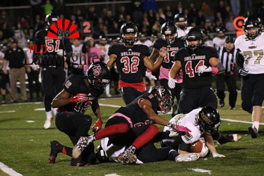 Dunbar players tackle their opponent.