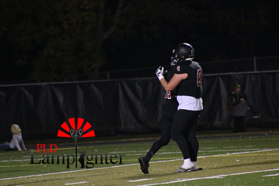 Tyler Browning (#8) comforts his teammate.