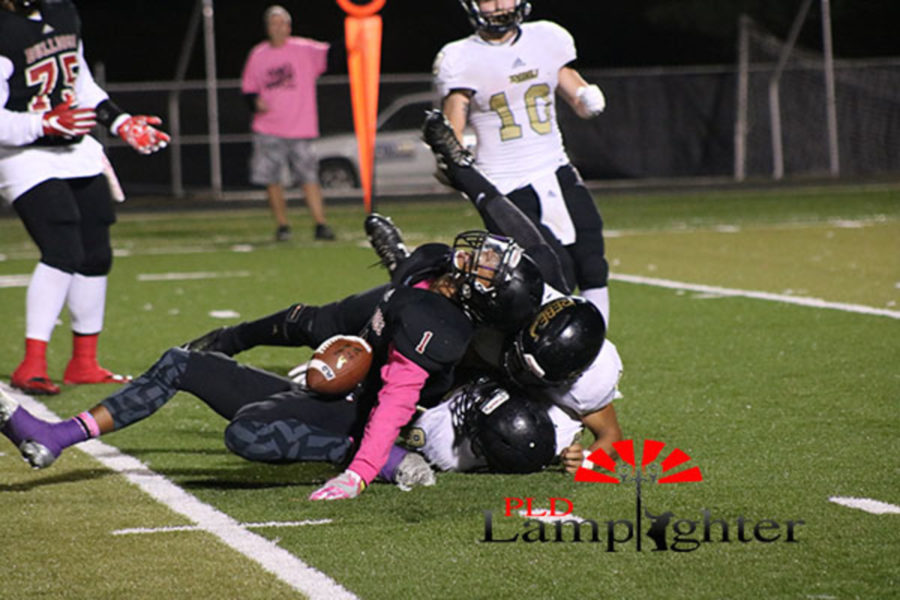 Tre Homer (#1) is tackled.