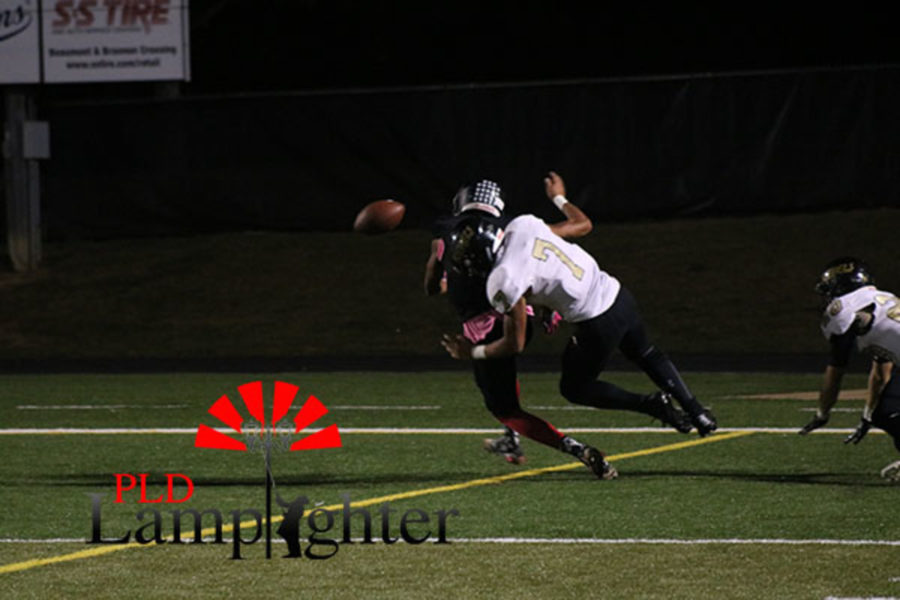 A Dunbar player fights for the ball.