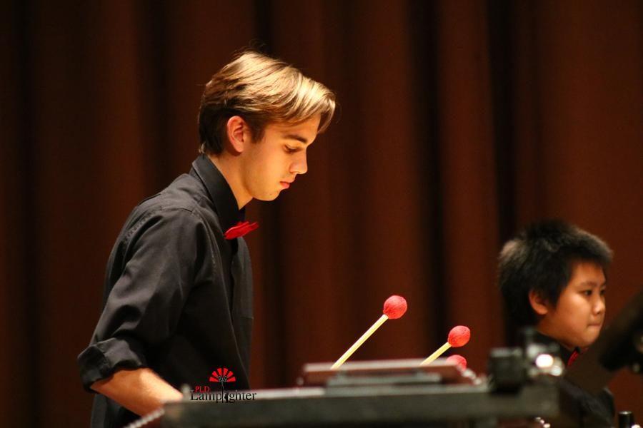 Wyatt Watson plays percussion.