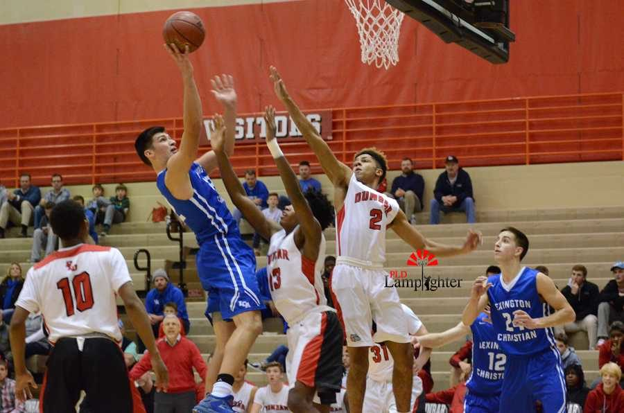 LCA player, Kyle Rode, goes up for a shot, but is blockec by Dunbar Players Isaiah Yeast (2) and Star Ifeacho (13)