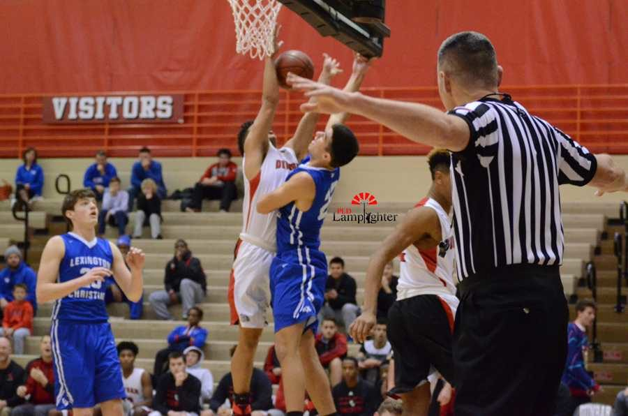 Sophomore Michael Corio goes up to block a LCA players shot.