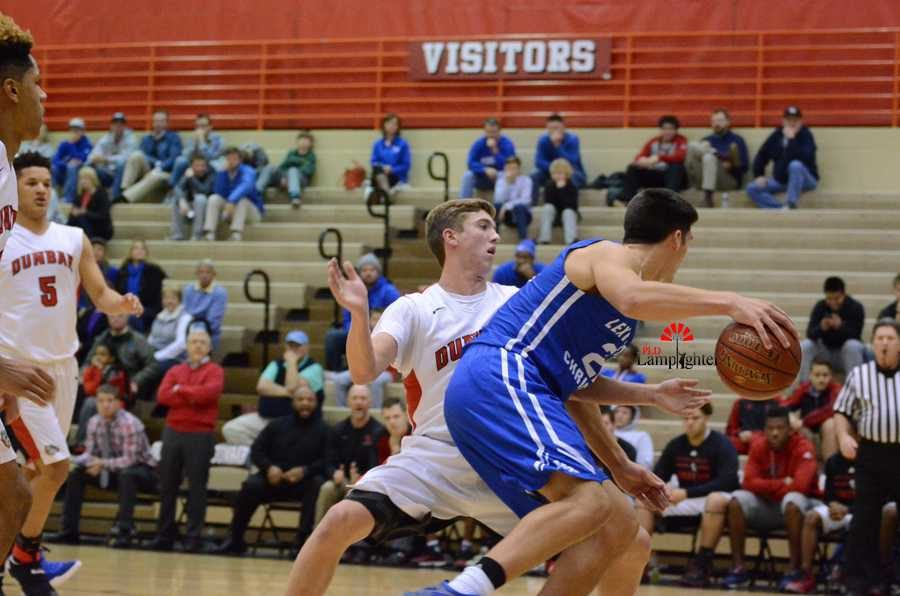Sophomore Jared Gadd blocks a player from the opposing team.