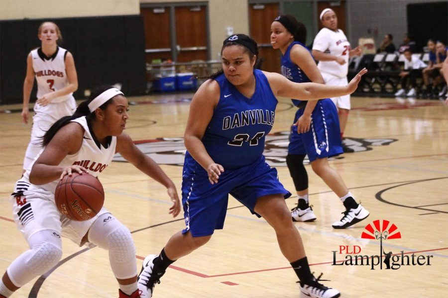 Junior, Mashayla Cecil dribbles around her opponent as she makes her way to the basket. Even as Danville's defense became more intense, the Bulldogs managed to defeat them.