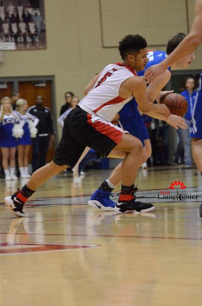 Sophomore Michael Corio attempts to steal the ball .