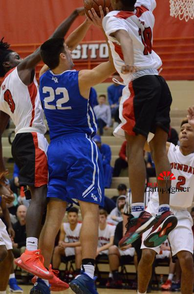 Junior JaQuice Gray blocks the layup from LCAs Kyle Rode