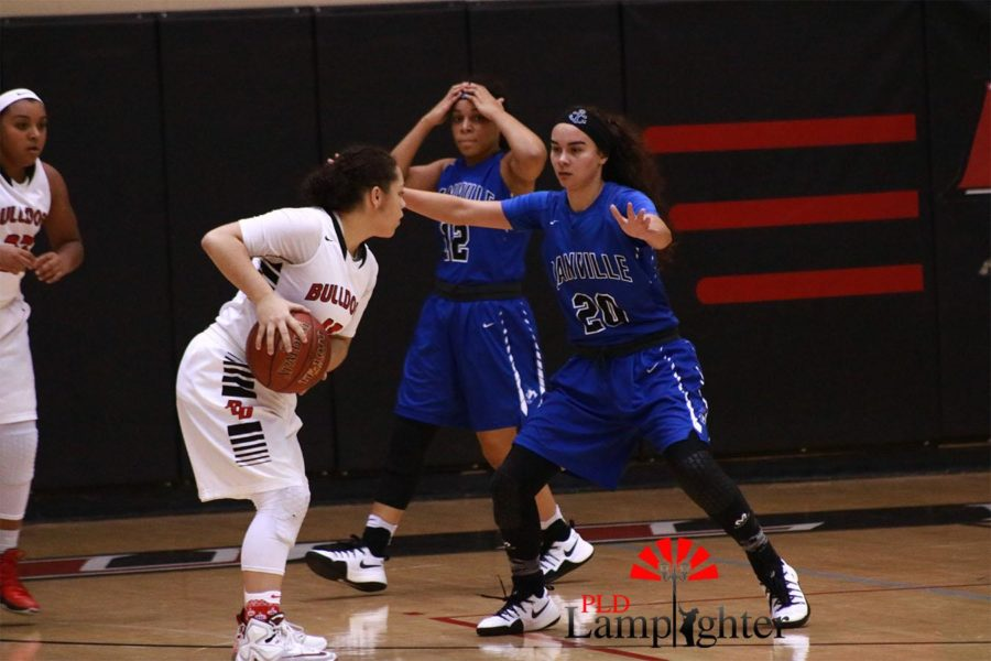 Jailyn Ginter holds the ball away from her opponent. The team showed tremendous effort on offense throughout the entire game.