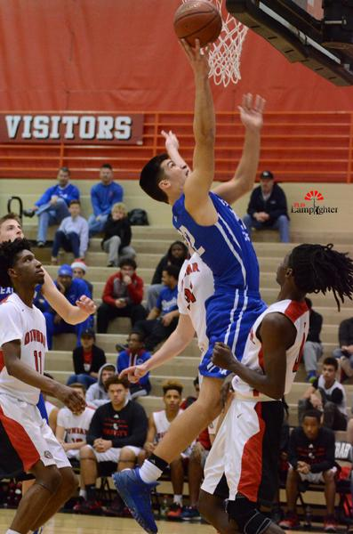 LCA player Kyle Rode goes up for a layup