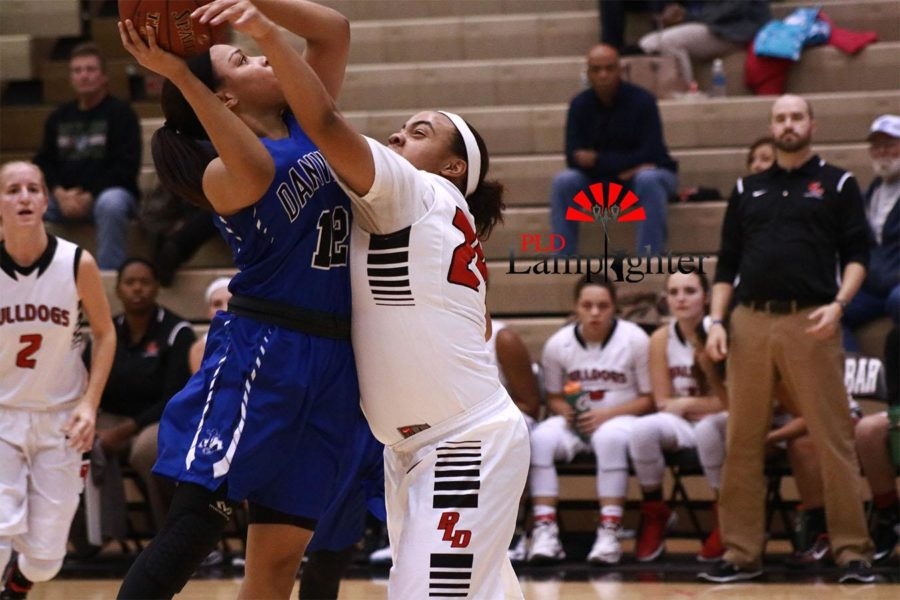 Junior, Anaiyah Cotton blocks her opponent from making the shot. The Lady Bulldogs struggled to stay ahead of Danville.