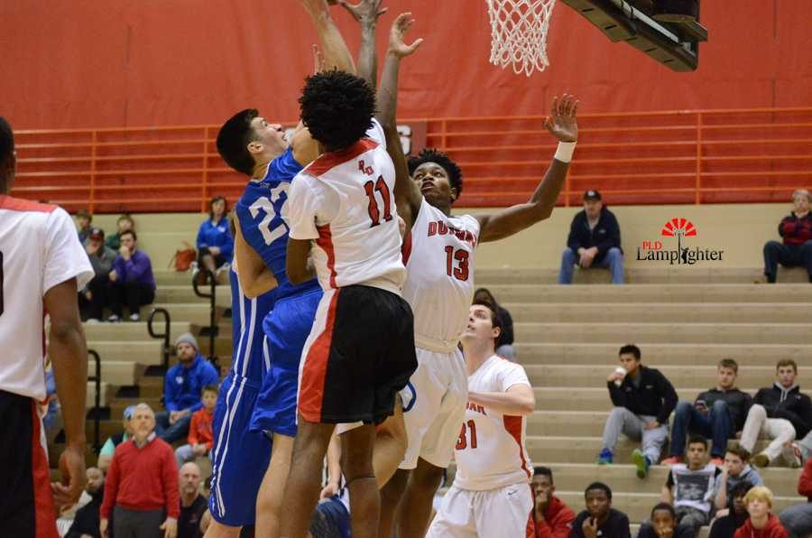 Attempted block by Taveion Hollingsworth and Star Ifeacho.