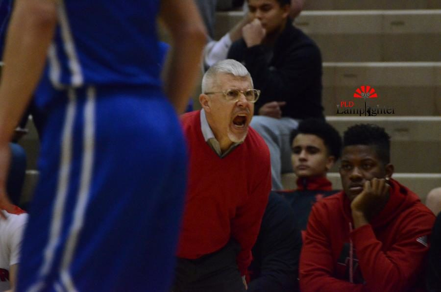 PLD Basketball Coach Mr. Scott Chalk yells to his players during the game.