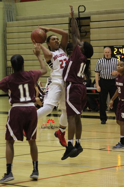Junior+Mashayla+Cecil+%2823%29+takes+a+shot+over+a+guard+from+the+other+team.
