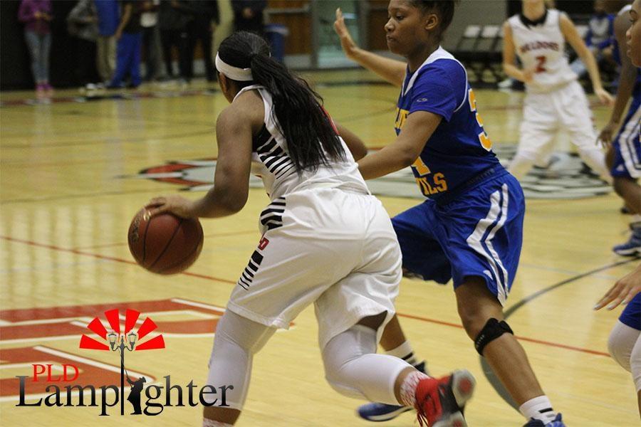 Mashayla Cecil dribbles around her opponent.