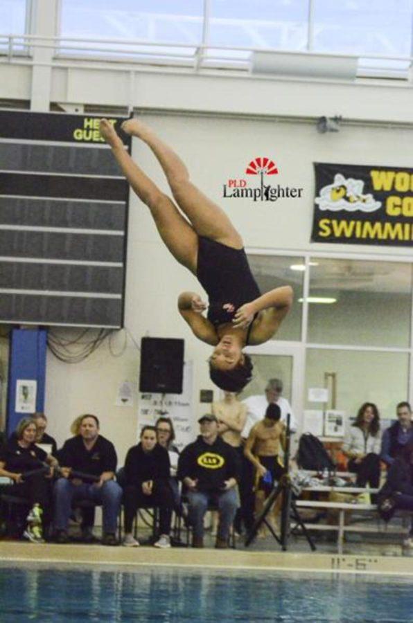 Junior Julia Radhakrishnan does a front somersault half-twist dive.