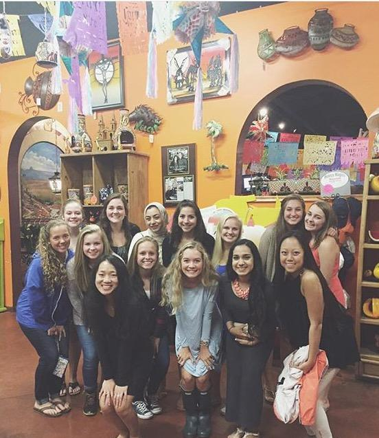 A group of Dunbar students pose before dinner in Rincon's gift shop