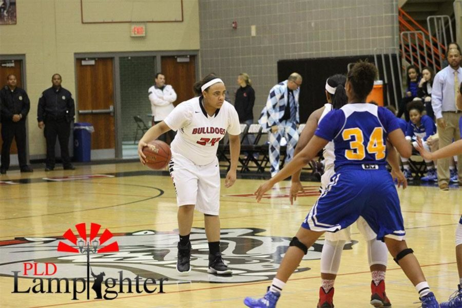 Anaiyah Cotton brings the ball down the court. The girls played good offense.