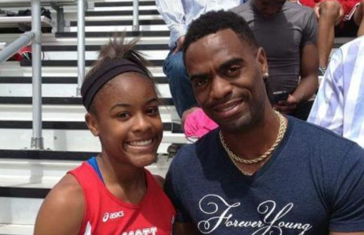 Trinity Gay with her father, Olympian Tyson Gay, at a Scott County High School meet.