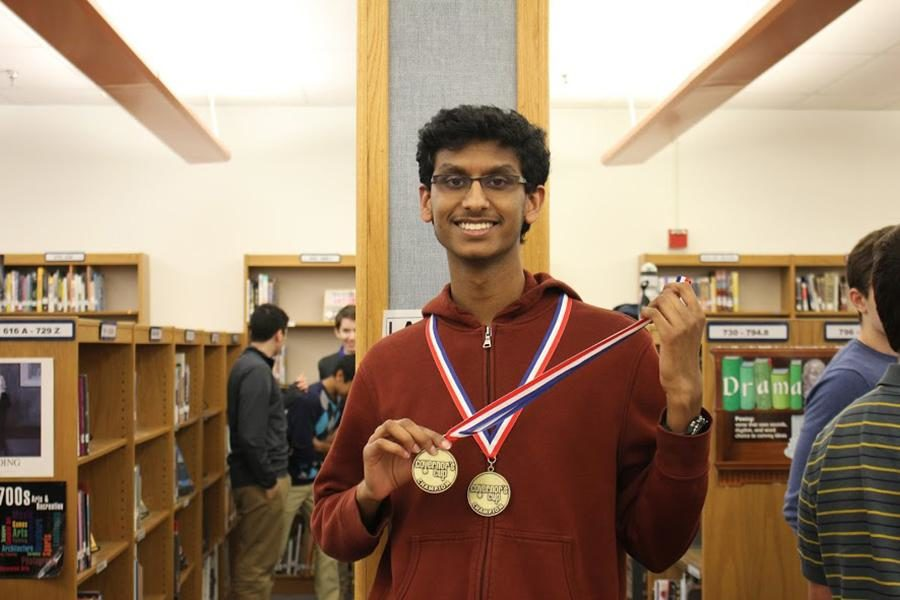 MSTC Junior Shashank Bhatt poses for a photo with his newly earned medal at the most recent academic team competition.
