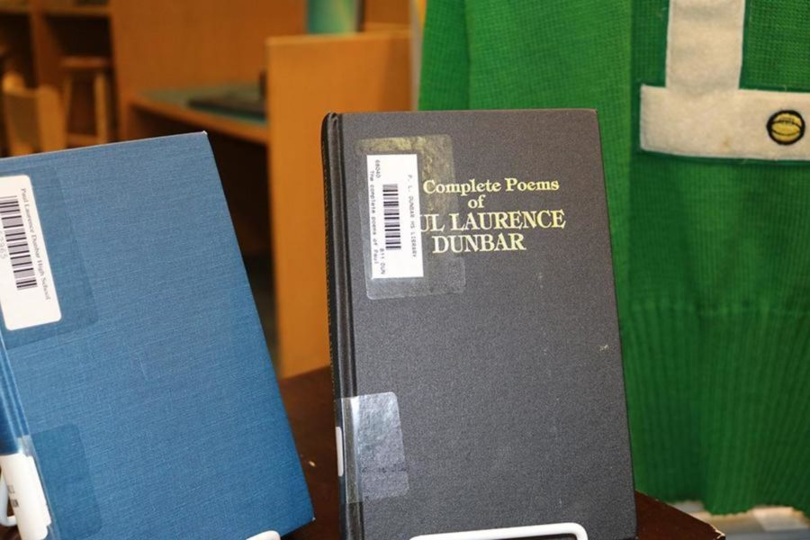 Poems by Paul Laurence Dunbar presented along with other Dunbar memorabilia.