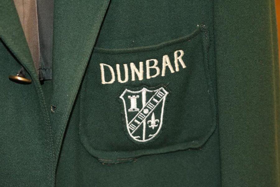 A symbol of the original Dunbar high school on the schools traditional green jackets.