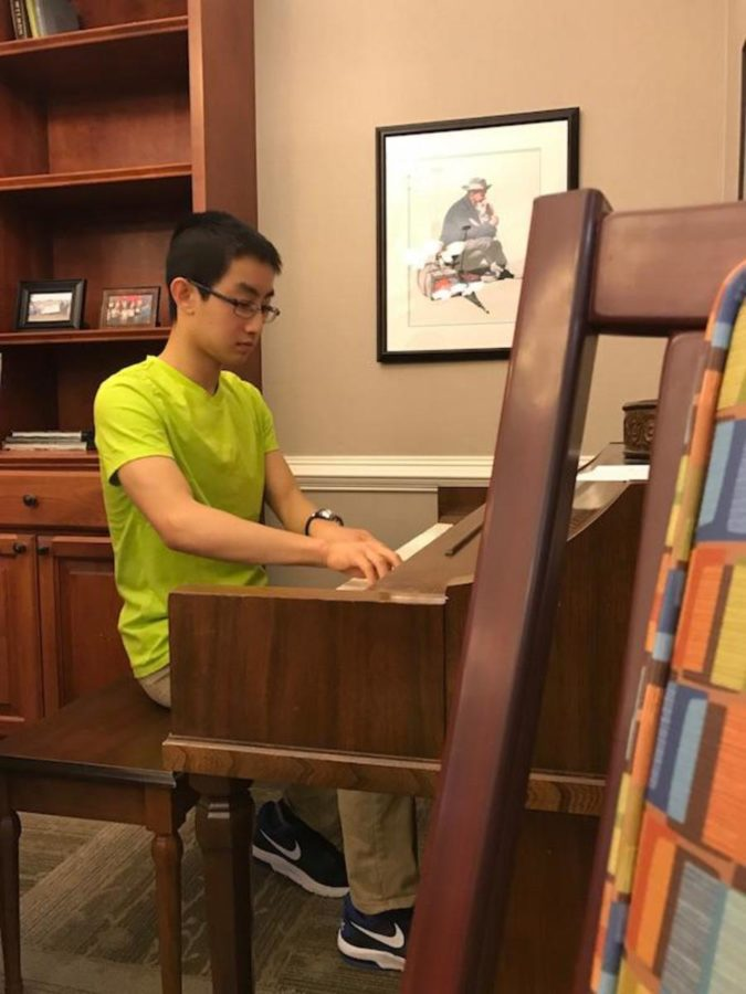 Sophomore Andy Du plays the piano for the senior citizens.