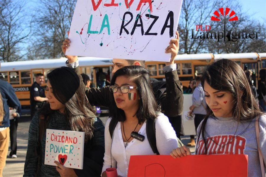 Senior Lori Martinez stands with her peers during an afternoon rally.