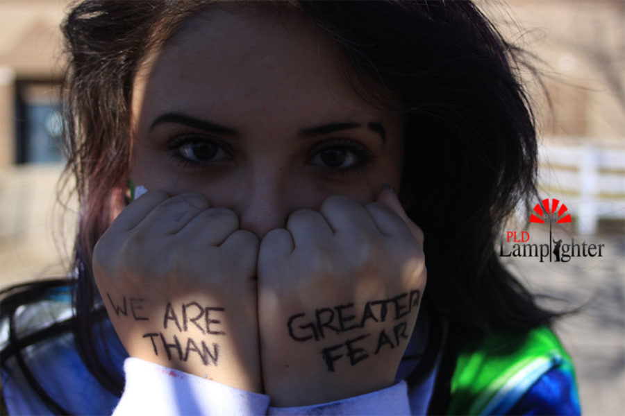 Samantha Contreras posing before the start of the rally on Feb. 17 at Dunbar High School.