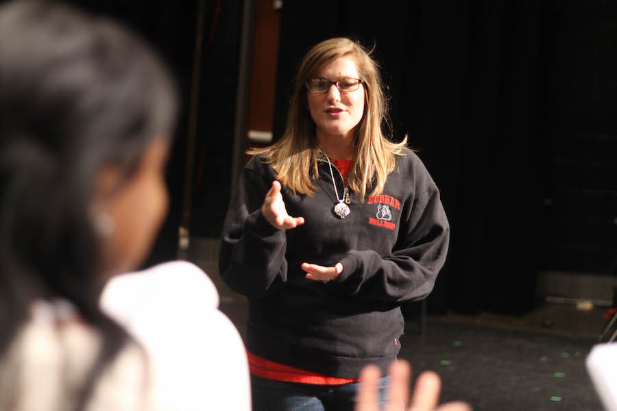 Mrs. Brooke Jackson directing students during the musical rehearsal.