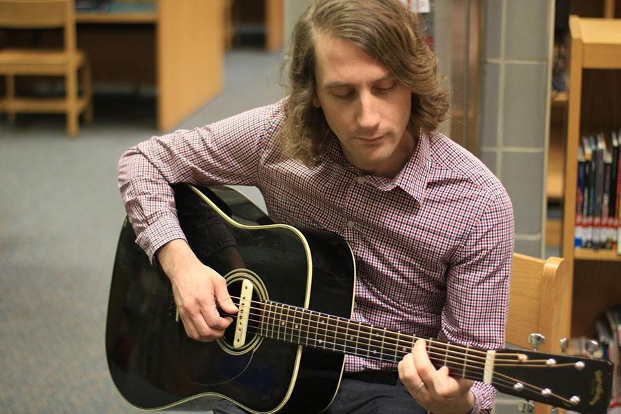 English teacher Mr. Trevor Tremaine plays guitar and other instruments in his band, ATTEMPT.