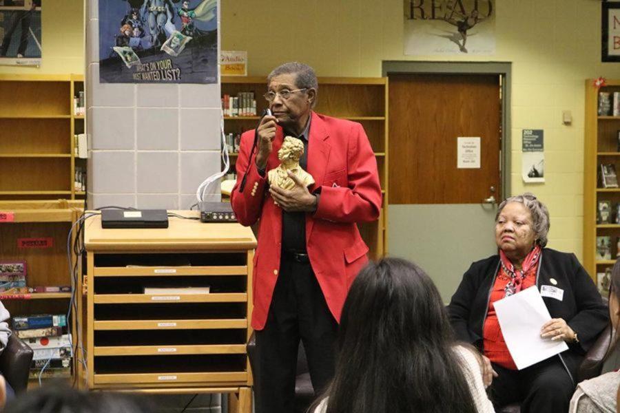 Mr. Julian Jackson Jr., alumni of the original Dunbar, answers students questions.