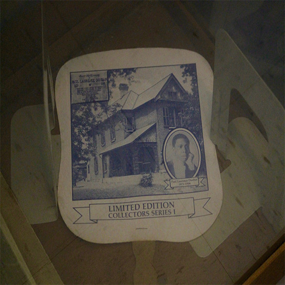 A published card of our school's namesake Paul Laurence Dunbar's childhood home accompanies a portrait of him.