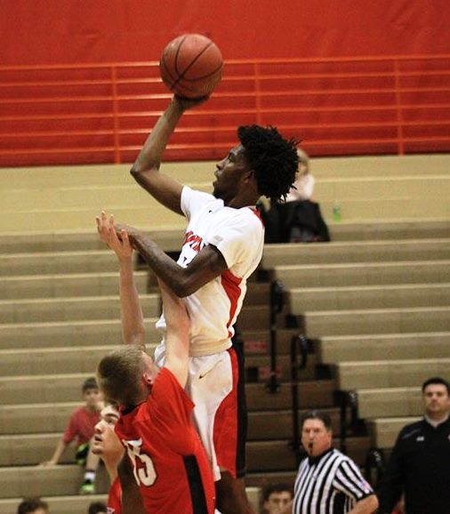 #11 Taveion Hollingsworth shooting a floater over a South Laurel player.