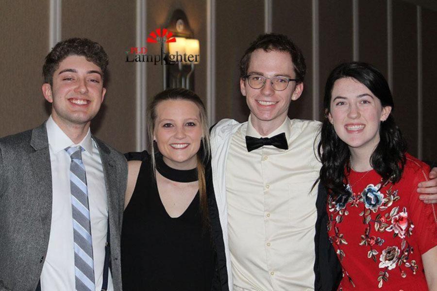 Noah Landry, Rachel Fister, Matt Jones and Amanda Judy before going through the buffet.