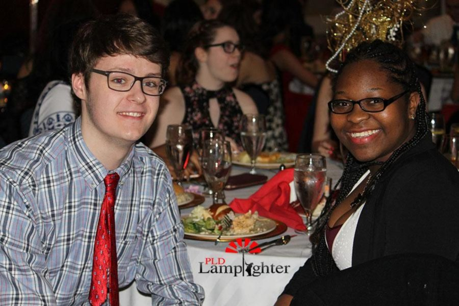 Zach Hall poses with Lamplighter broadcast editor, Addie Brown, during the dinner.