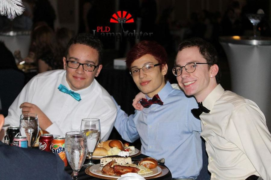 Adrian Bard and Lamplighter Staff Members Andres Calleja and Matt Jones during dinner.