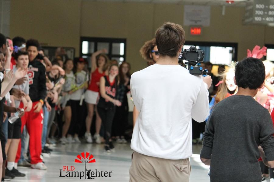 Senior Jack Stokely films students singing and cheering for the lip dub.