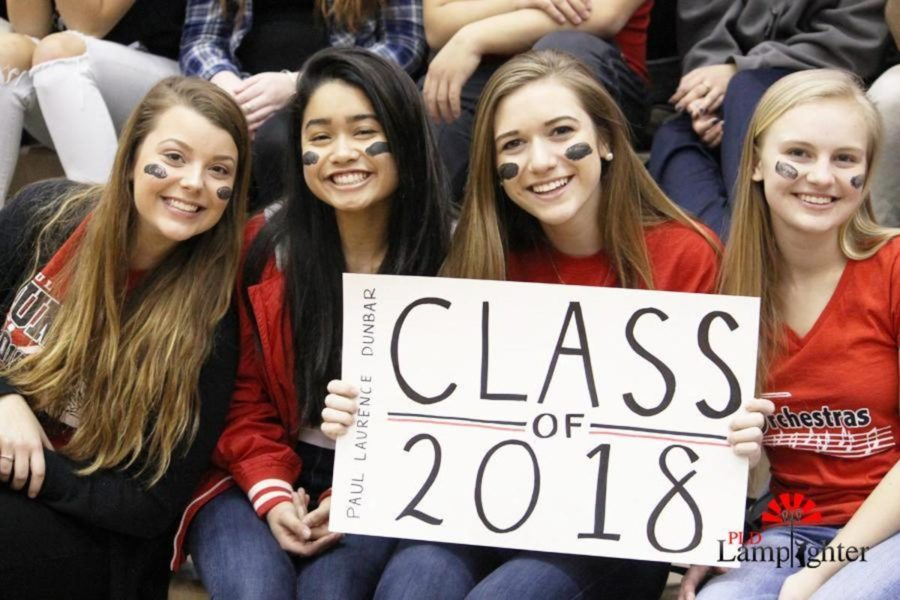 Juniors Olivia Geveden, Jasmine Ahmad, Madi Halwes, and Frankie Rice hold up a sign to represent the Class of 2018.