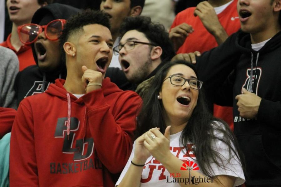 Sophomores Michael Corio and Katrina Contreras join the rest of their class in singing the Dunbar fight song.